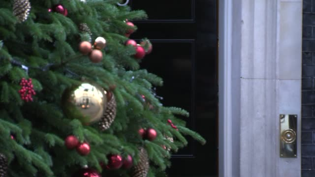 cabinet arrivals at no10 downing street england london downing street no10 christmas tree in shot outside no10 liam fox mp arrival / jeremy wright mp... - liam fox politician stock videos and b-roll footage