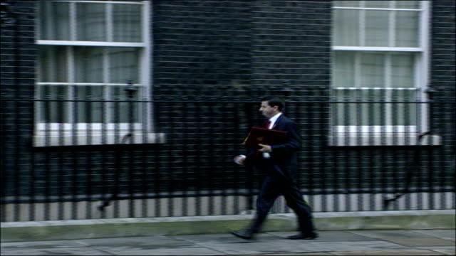 cabinet arrivals at number 10; douglas alexander mp along into no 10 - ダグラス アレキサンダー点の映像素材/bロール