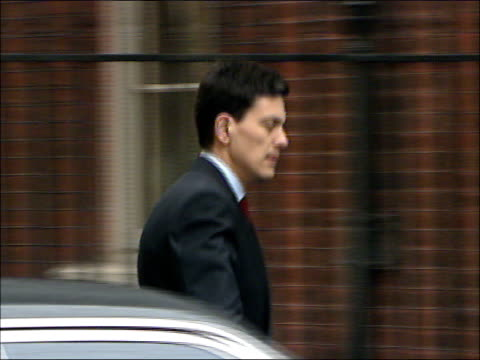 cabinet arrivals at number ten downing street david miliband mp through gate along and entering building with douglas alexander mp / ruth kelly mp... - douglas alexander stock videos & royalty-free footage