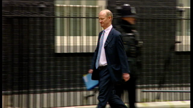 London Downing Street EXT Eric Pickles MP arrival/ Dave Willets MP arrival/ Liam Fox MP arrival/ Jeremy Hunt MP arrival/ Unidentified man arrives...