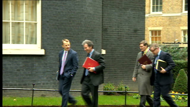London Downing Street EXT Lord Strathclyde out of car and says 'Happy New Year' to press then away inside Number 10 SOT / Kenneth Clarke MP out of...