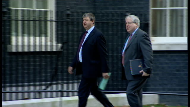 london downing street ext michael moore mp along and into number ten/ sir george young mp along and into number 10/ andrew lansley mp along and into... - sir george young politician stock videos and b-roll footage