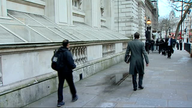 london whitehall downing street ext sir george young and andrew lansley mp walking along and through gates / dominic grieve walking along whitehall /... - ロンドン ホワイトホール点の映像素材/bロール