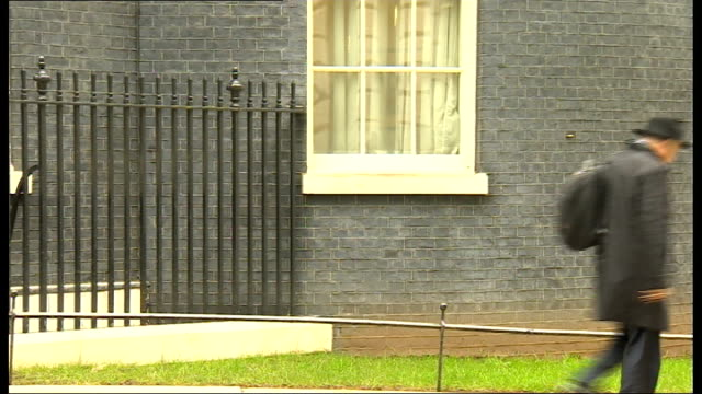 london downing street ext oliver letwin mp departing no 10 looking at his mobile phone / vince cable mp leaving / baroness warsi leaving / jeremy... - sir george young politician stock videos and b-roll footage