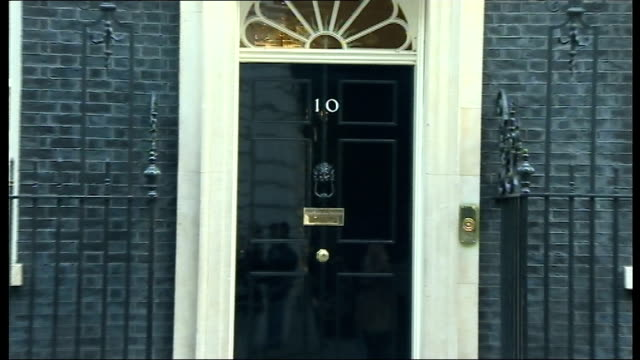 london downing street ext stephen crabb mp departing number 10 and philip hammond mp along / danny alexander mp departing / number ten doorway /... - patrick mcloughlin stock videos and b-roll footage