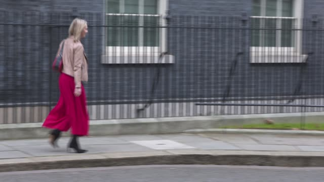 london westminster downing street ext julian smith mp departing number 10 then turning around and into car / liz truss mp departing / poor quality... - liam fox politician stock videos and b-roll footage