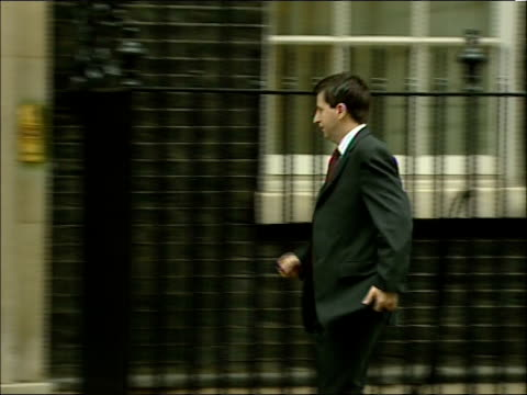 cabinet meeting arrivals at downing street douglas alexander mp walks along and into no10 followed by delivery man - douglas alexander stock videos & royalty-free footage
