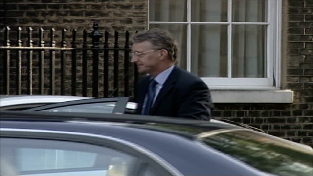 cabinet meeting arrivals hilary benn mp from car followed by jack straw mp then along into no 10 - hilary benn stock-videos und b-roll-filmmaterial