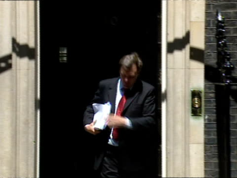 cabinet ministers arrive for meeting at downing street: arrivals and departures; ed balls mp out from number 10 and away - cabinet member stock videos & royalty-free footage