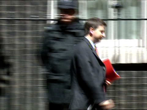 cabinet ministers arrive for meeting at downing street: arrivals and departures; douglas alexander mp out from number 10 and away - douglas alexander stock videos & royalty-free footage