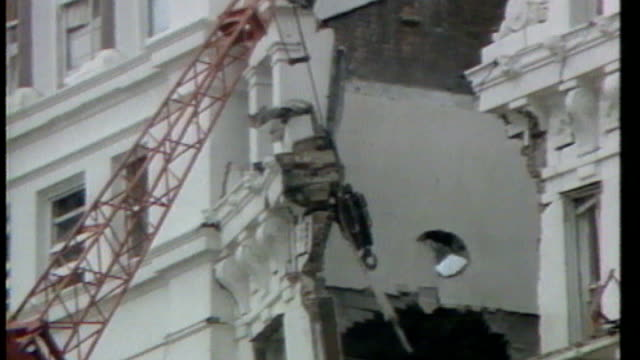 miners' strike / government 'pit closure plan' lib england sussex brighton ext crane removing damaged section of hotel where conservative party... - brighton brighton and hove stock-videos und b-roll-filmmaterial
