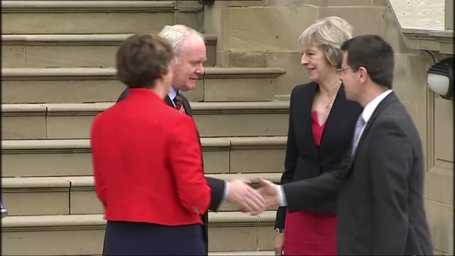 cabinet reshuffle 1572016 / r25071602 belfast stormont ext theresa may mp and james brokenshire mp along to greet arlene foster mla and martin... - stormont stock videos and b-roll footage