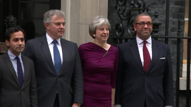 Brandon Lewis Theresa May MP and James Cleverly posing for photocall outside Number 10 with staff members including Ben Bradley MP and Kemi Badenoch...