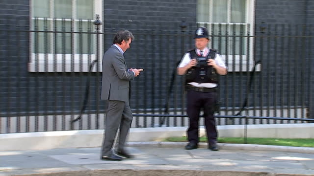 downing street departures; england: london: downing street: ext william hague mp leaving no. 10 / oliver letwin mp leaving no.10 / lord hill arriving... - 内閣改造点の映像素材/bロール