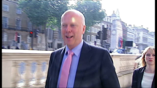 cabinet reshuffle; england: london: ext chris grayling mp along towards downing street gates / interview sot - a lovely day for a walk along whitehall - 内閣改造点の映像素材/bロール