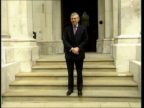 cabinet reshuffle; england: london: home office: ext cms guide dog tilt up david blunkett mp posing for photocall david blunkett posing for photocall... - david blunkett stock videos & royalty-free footage