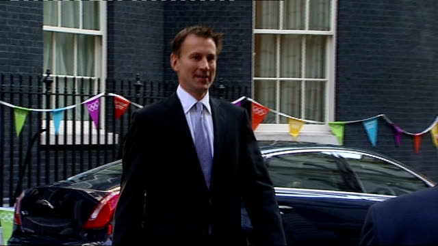 cabinet reshuffle; ext various shots of jeremy hunt mp emerging from downing street / hunt approaches journalists sot - it's a huge task, it's the... - biggest stock videos & royalty-free footage