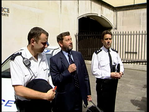 cabinet reshuffle; itn england: london: downing street: ext lms tony blair mp wearing jeans, short sleeved shirt & carrying red ministerial case... - short sleeved stock videos & royalty-free footage