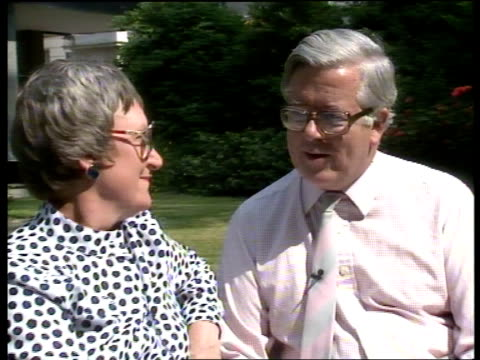 cabinet reshuffle; itn lib ext carlton terrace cms sir geoffrey and wife elspeth sitting in garden zoom in sir geoffrey - 内閣改造点の映像素材/bロール