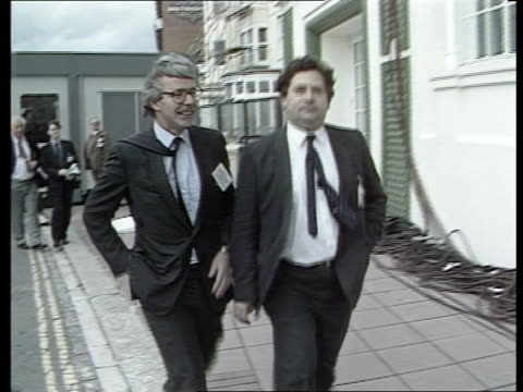 john major profile; itn lib england: brighton treasury sec john major chatting chancellor nigel lawson major & lawson towards track back l-r to bv... - 内閣改造点の映像素材/bロール