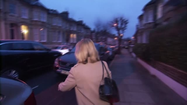 Justine Greening doorstep ENGLAND London EXT Justine Greening MP from house and along into car