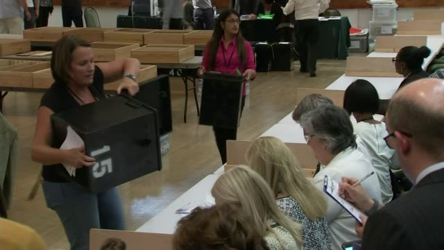 cabinet reshuffle; lib / battersea: man emptying ballot box people counting votes ballot box emptied and count gvs votes counted - ballot box stock videos & royalty-free footage