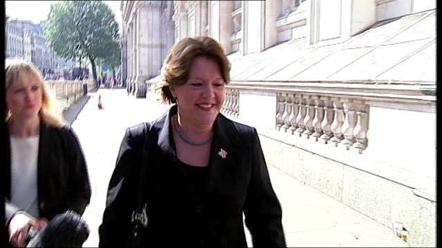 cabinet reshuffle; maria miller mp along whitehall pursued by press - 内閣改造点の映像素材/bロール