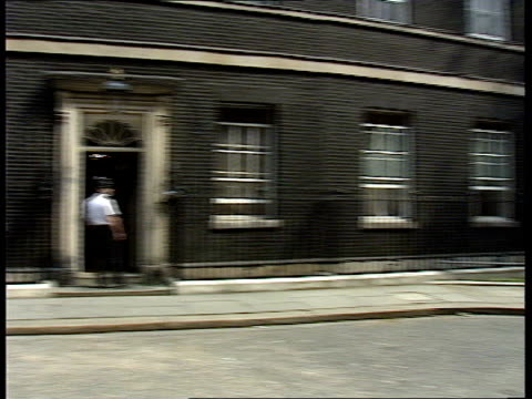 ministers at downing street; itn england: london: downing street: ext no 10 / door of no 10 / windows / no 10 / gardener watering flower beds outside... - 内閣改造点の映像素材/bロール