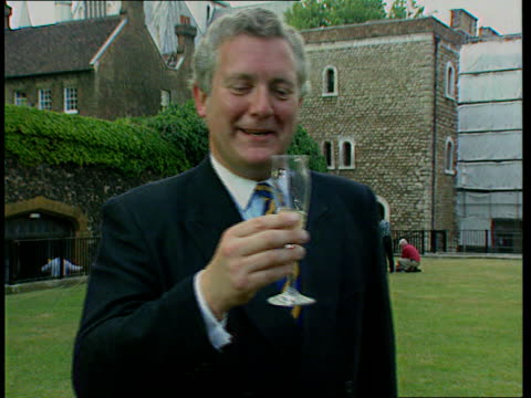 cabinet reshuffle; nat: england: london: westminster cms jeremy hanley mp toasts his appointment with a glass of champagne l-r smith square:... - 内閣改造点の映像素材/bロール