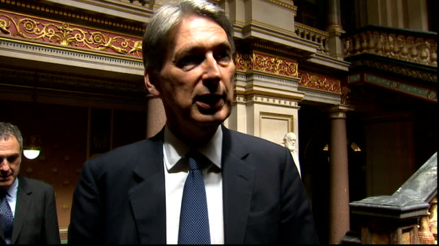 Philip Hammond reaction ENGLAND London Foreign Office EXT Car arriving / Philip Hammond MP out of car shaking hands and into building Philip Hammond...