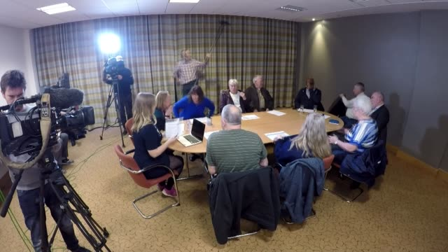 voter reaction ENGLAND SEQUENCE / TIMELAPSE swing voter focus group members taking seats around table