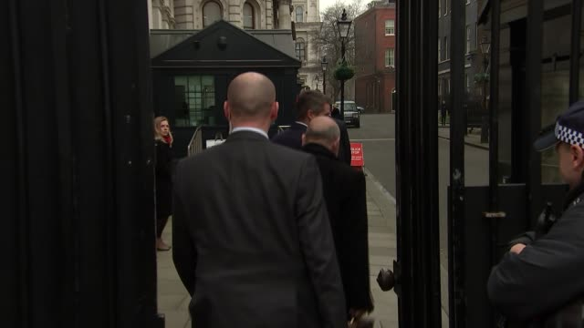 Whitehall gate arrivals and departures ENGLAND London Whitehall EXT Man along from gates / Car through gates and Jeremy Wright MP from car / cars...