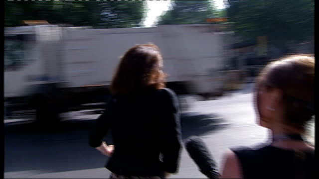 cabinet reshuffle; whitehall: theresa villiers mp along with bike doorstep interview sot - really delighted, can't wait to get started downing... - 内閣改造点の映像素材/bロール