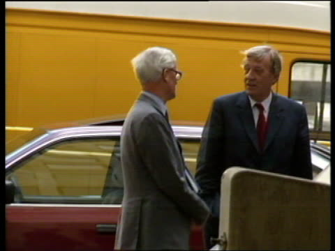 reaction b Includes Library material ENGLAND London Home Office Douglas Hurd stands chatting in car park