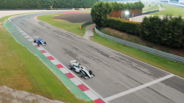 ts cable cam: formula cars racing on the track - sports track stock videos & royalty-free footage
