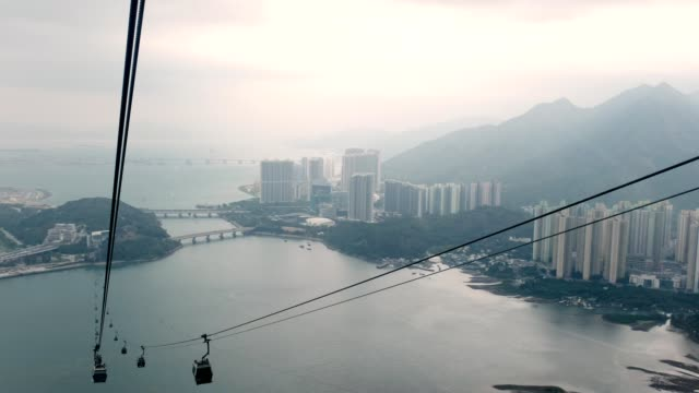 cable car cabin moving on hong kong island to ngong ping temple - overhead cable car stock videos and b-roll footage