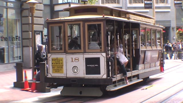 stockvideo's en b-roll-footage met cable car in san francisco with people on and off cable car san francisco on september 15 2010 - salmini