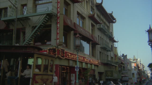 ms pan tu cable car moving in front of chinatown/ san francisco, california, united states - cable car stock videos & royalty-free footage