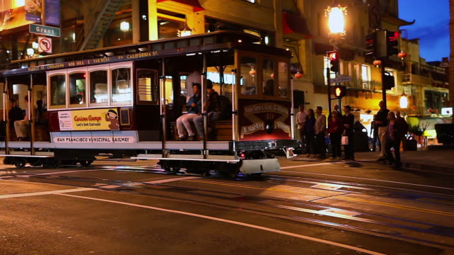 MS TS Cable car passing by in crowded area in city / San Francisco, California, United States
