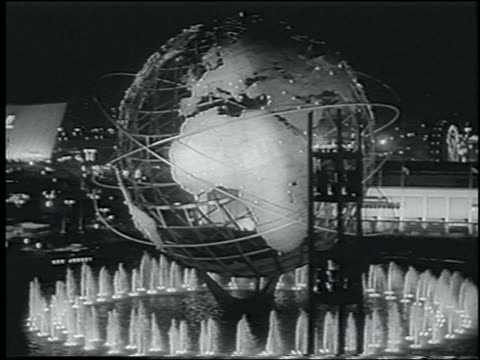 vidéos et rushes de b/w 1964 cable car point of view of unisphere at night / cable car passes in foreground / ny world's fair - exposition universelle de new york