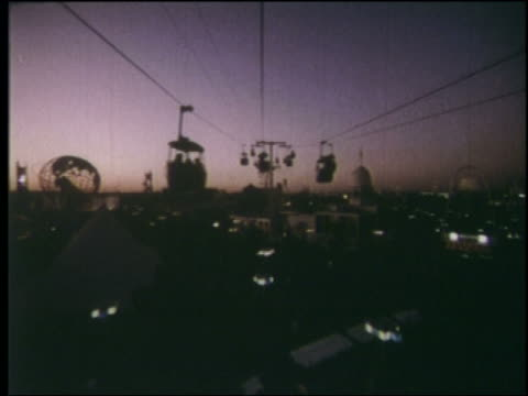 1964 cable car point of view over ny world's fair with silhouetted cable cars at twilight - 1964年点の映像素材/bロール