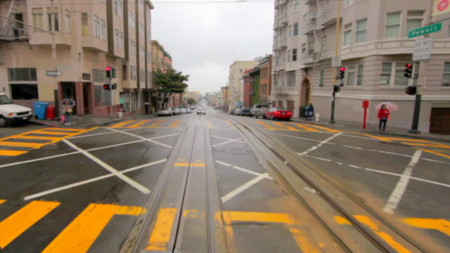 rear pov cable car riding down hyde street, san francisco,  california, usa - tram point of view stock videos and b-roll footage