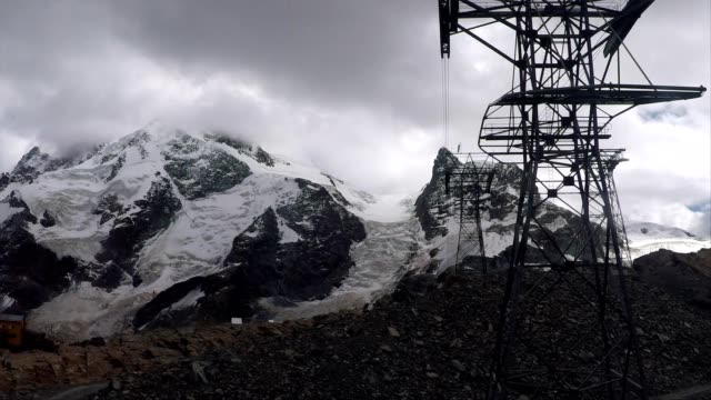 cable car travelling over glacier towards klein matterhorn mountain, swiss alps - ski lift point of view stock videos & royalty-free footage