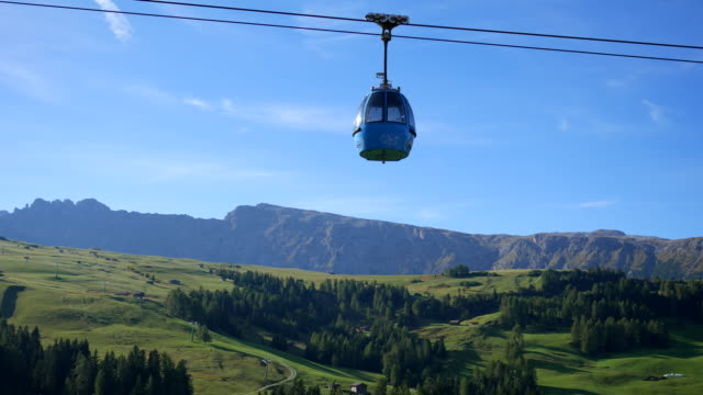 cable car with mountain ,dolomite italy - overhead cable car stock videos and b-roll footage
