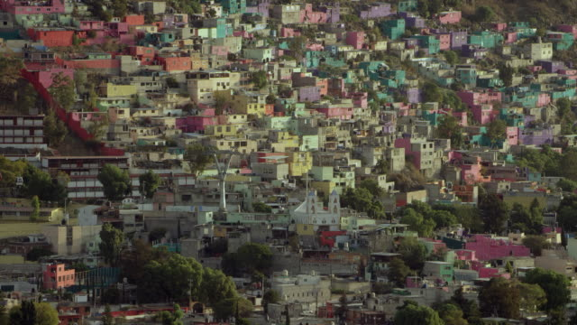 cable cars and colorful houses in mexico city suburb - urban sprawl stock videos & royalty-free footage