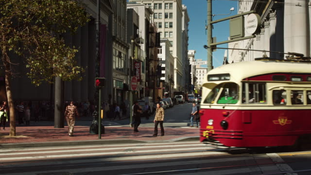 cable cars in traffic on market st, san francisco - public transportation stock videos & royalty-free footage