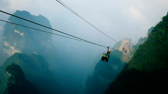 cable cars moving up in mountain - overhead cable car stock videos and b-roll footage