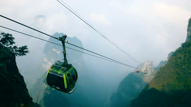 cable cars moving up in mountain - cable car stock videos & royalty-free footage