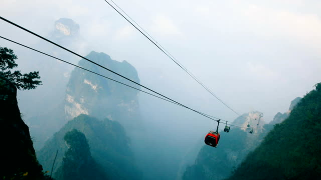 Cable cars moving up in mountain