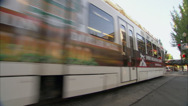 ms pan ws cable cars on street / portland, oregon, usa - portland oregon old town stock videos & royalty-free footage